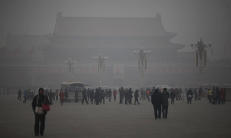 People walk on Tiananmen Square as heavy pollution lingers in the air. Photograph: Diego Azubel/EPA